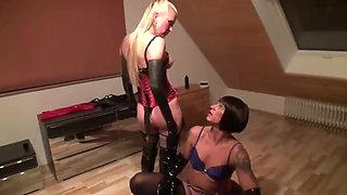 2 women have fun with a crossdresser ass