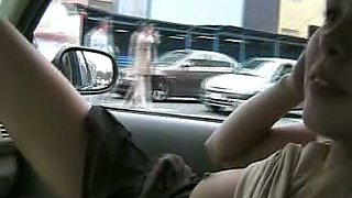 Busty and lascivious Russian blondie in the car shows her breasts