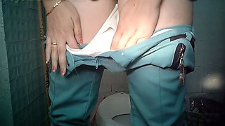 Chunky mature white woman in the public toilet room for ladies