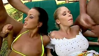 Two horny bitches enjoying two hard cocks on the swimming pool