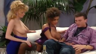 Busty and mesmerizing majestic ladies on the couch start a threesome action
