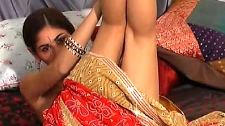 Fresh and beautiful Indian teen in saree stripteases