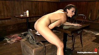 Superb brunette chick rides a dildo fixed to a saddle