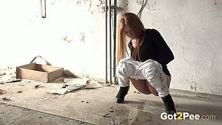 Stunning teen babe in the abandoned building pissing