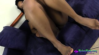 Janelle in black pantyhose rubs pussy