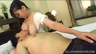 Sucking on her luscious breasts and nipples while getting a handjob