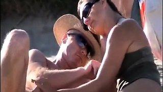 Beach voyeur finds horny amateur ladies stroking hard meat