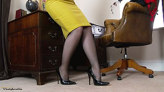 Older blonde shows what she has got in an office environment