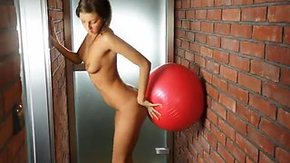 Young flexible brunette shows her abilities