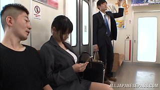 An Asian office chick gets banged by several guys on a train