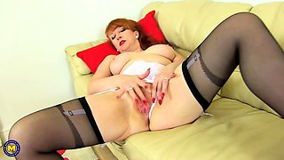British housewife fooling around with a glass dildo