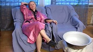 Chubby and nerdy blonde milf called Luba strips and pees in a bowl