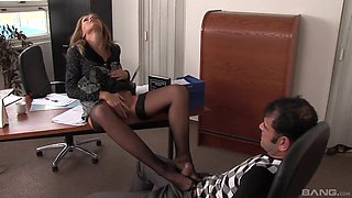 Lauryn May uses her feet to make a dick hard before sex