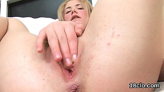 Lovesome girl is gaping soft pussy in close-up and having or