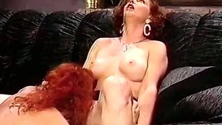 Gorgeous redhead European babes on the couch in softcore action