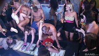 Lustful pornstars gather in a club for a sweaty fuck fest