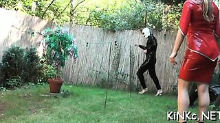 Naughty dominatrix ties up her slave and gives him a handjob