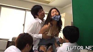 Oriental teacher gives a cook jerking and rides schlong