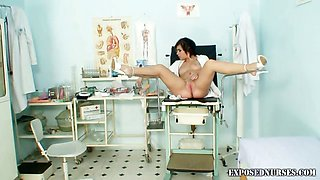 Teen nurse is smiling striping and pussy stretching