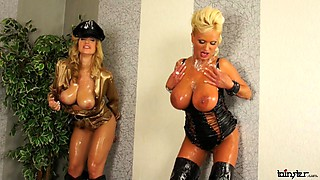 Chicks with huge tits team up and play in a gloryhole