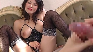 Japanese dominatrix works her slave's cock with her hand