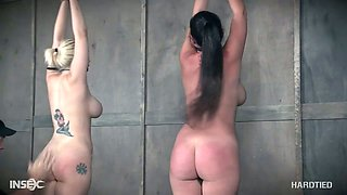 Busty whore Nadia White and her big bottomed partner are punished in the dark basement