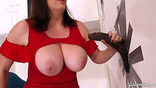 Ample breasted plumper Maggie Green goes wild in the glory hole room