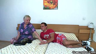 Moaning granny rides young meat