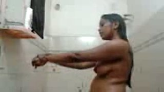 Busty dark skin amateur aunty showering nude on cam