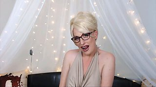 Sophisticated cougar with sexy glasses and stockings