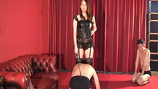 The Domina relentlessly knocks slaves with a whip