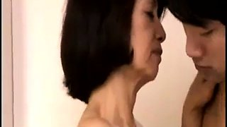 Horny Japanese granny uses a young cock to please herself