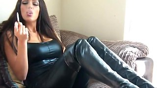 Sexy brunette in leather smoking fetish