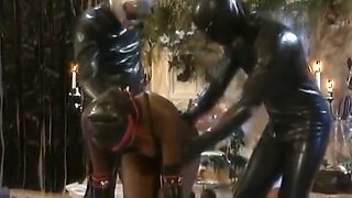 African Slave Gets Abused By Horny Guys In Latex