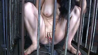 Prisoned brunette chick lives in cage and pees to bucket