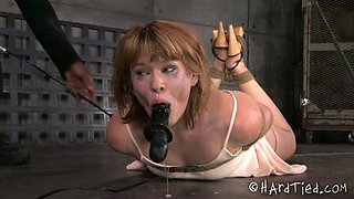 BBC dildo fucks mouth of tied up naughty red head