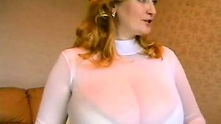 Busty blonde with huge tits teasing and seducing on webcam