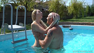 Lulu Love fucks a handsome lover while in a swimming pool
