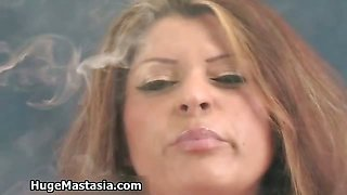 Sexy brunette girl gets horny smoking
