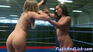 Wrestling dyke fingered while queening babe