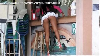 Gorgeous Latina waitress is wearing a really short white skirt